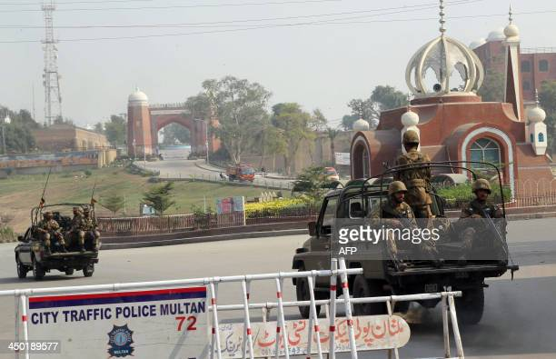 Pakistani soldiers patrol in a tense area of Multan city on November 17 2013 following sectarian clashes Pakistan ordered an inquiry into sectarian...