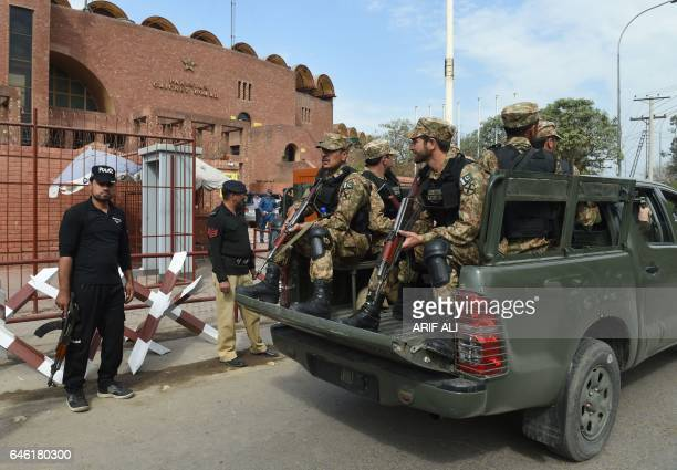 Pakistani soldiers patrol outside the Gaddafi Cricket Stadium in Lahore on February 28 ahead of the final cricket match of the Pakistan Super League...