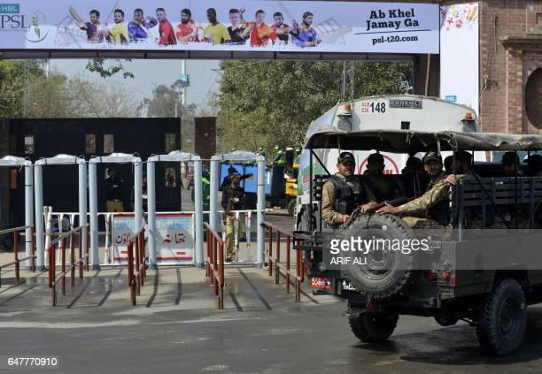 Pakistani soldiers patrol outside the Gaddafi Cricket Stadium in Lahore on March 4 ahead of the final cricket match of the Pakistan Super League...