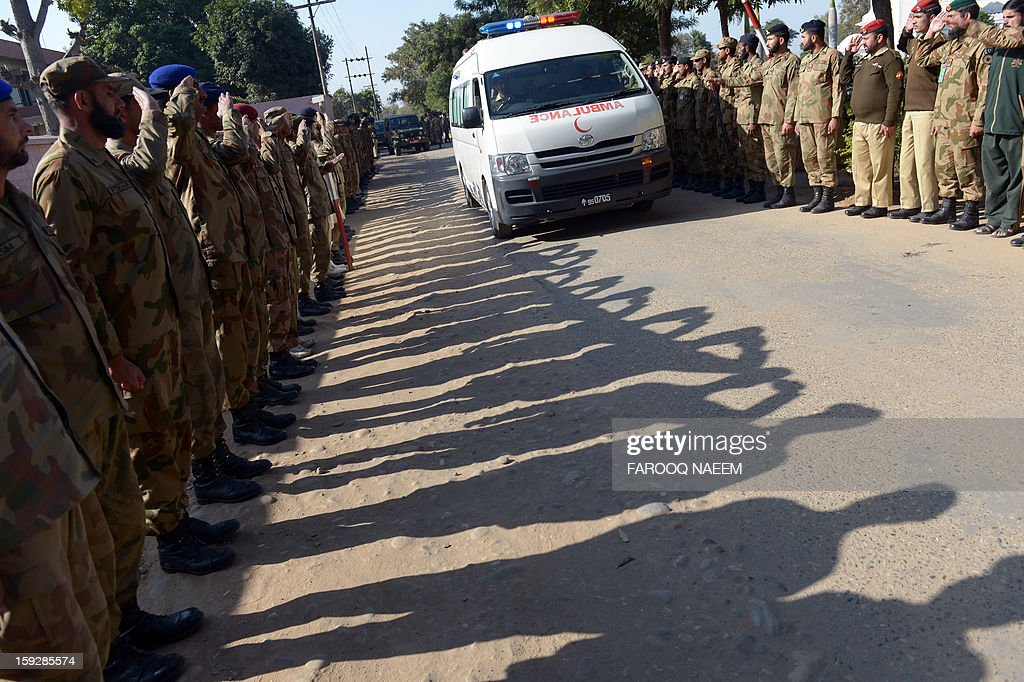 Pakistani soldiers salute an ambulance transporting the coffin of their fallen comrade Havildar (Sargeant) Mohyuddin, who was allegedly shot by Indian troops at the Hotspring sector in Battal in Pakistan-administered Kashmir, after funeral prayers in Jhelum some 100 kms of Islamabad on January 11, 2013. Pakistan said one of its soldiers was killed January 10 by 'unprovoked' Indian firing across their tense border in Kashmir, the third deadly incident reported in five days in the disputed region.