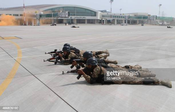 Pakistani soldiers take part in a drill against terrorists at the Multan International Airport in Multan on March 19 2015 Pakistan Army Air Force and...