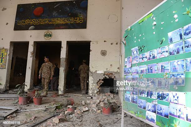 Pakistani soldiers walk amidst the debris in an armyrun school a day after an attack by Taliban militants in Peshawar on December 17 2014 Pakistan...