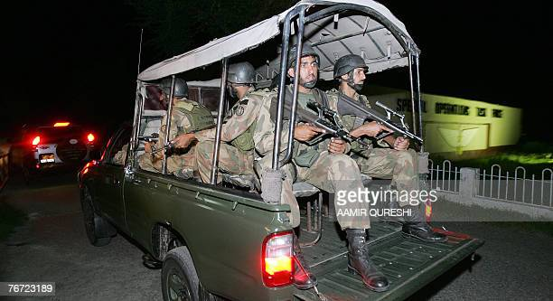 Pakistani special army commandos guard the suspected suicide blast site in Tarbela Ghazi about 70 kilometres northwest of Islamabad 14 September 2007...