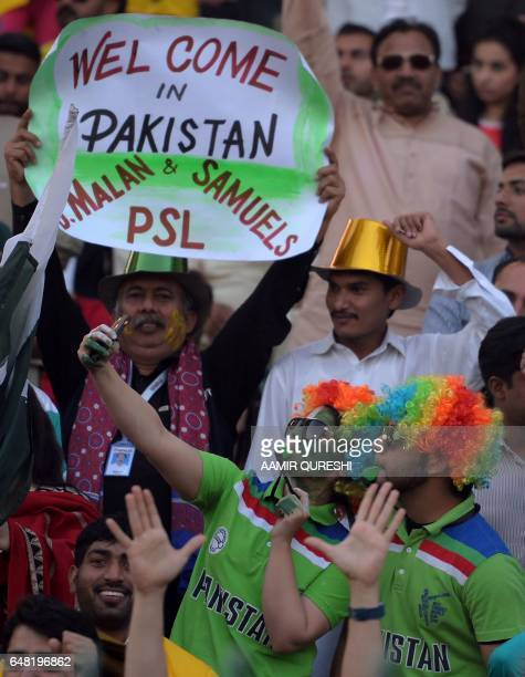Pakistani spectators cheer as others take a 'selfie' prior to the start of the final cricket match of the Pakistan Super League between Quetta...