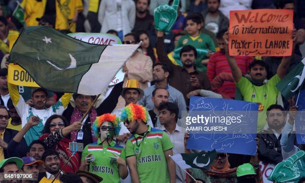 Pakistani spectators cheer prior to the start of the final cricket match of the Pakistan Super League between Quetta Gladiators and Peshawar Zalmi at...