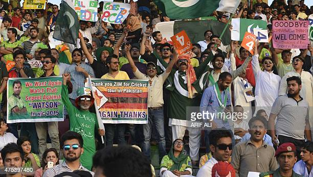 Pakistani spectators enjoy the third and final one day international match between Pakistan and Zimbabwe team at the Gaddafi Cricket Stadium in...