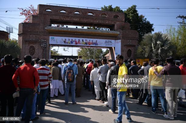 Pakistani spectators queue at an entry gate of The Gaddafi Cricket Stadium in Lahore on March 5 as they arrive to watch the final cricket match of...