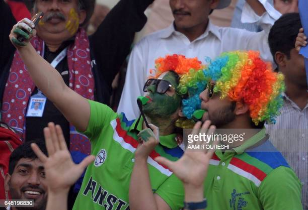 Pakistani spectators take a 'selfie' prior to the start of the final cricket match of the Pakistan Super League between Quetta Gladiators and...