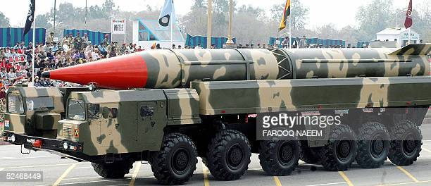 Pakistani spectators watch the Shaheen II longrange missile capable of carrying a nuclear warhead on its launcher during the National Day parade in...
