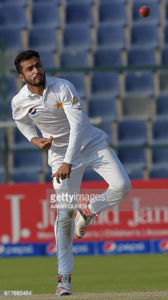 Pakistani spinner Mohammad Nawaz delivers the ball on the fourth day of the second Test between Pakistan and the West Indies at the Sheikh Zayed...