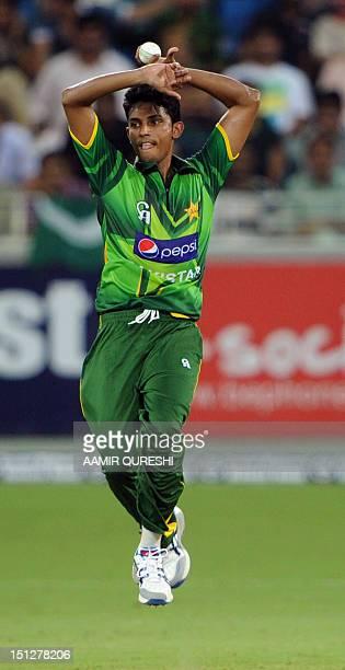 Pakistani spinner Raza Hasan bowls during their first Twenty20 match against Australia in the Gulf emirate of Dubai international cricket stadium on...