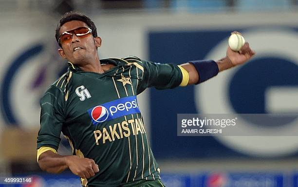 Pakistani spinner Raza Hasan delivers the ball during the second and last International T20 cricket match at Dubai International Stadium in Dubai on...