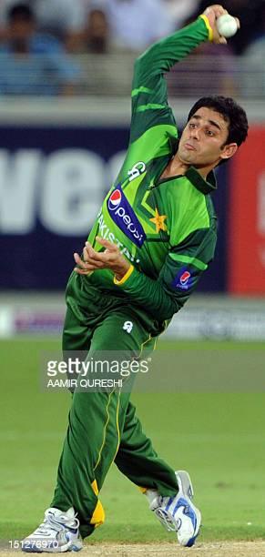 Pakistani spinner Saeed Ajmal bowls during their first Twenty20 match against Australia in the Gulf emirate of Dubai international cricket stadium on...