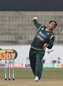 Pakistani spinner Saeed Ajmal delivers a ball during the One Day match with the visiting Kenyan team at the Gaddafi Cricket stadium in Lahore on...