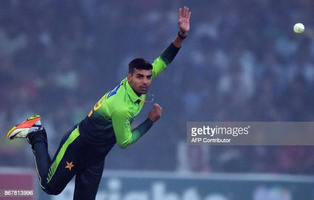 Pakistani spinner Shadab Khan delivers a ball during the third and final T20 cricket match between Pakistan and Sri Lanka at the Gaddafi Cricket...