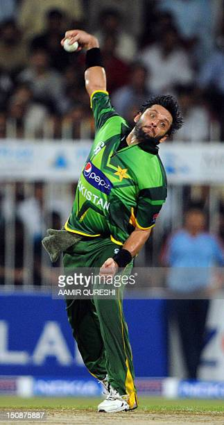 Pakistani spinner shahid Afridi delivers the ball during the first One Day International cricket match between Pakistan and Australia at the Sharjah...
