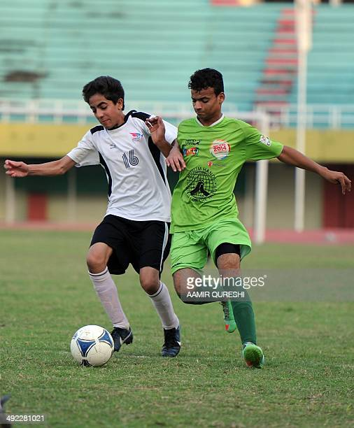 Pakistani street children and local footballers play a friendly match at a stadium in Islamabad on May 19 2014 In March 2014 a team from Karachi...