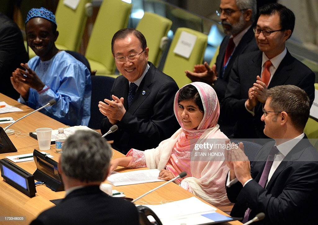 Pakistani student Malala Yousafzai (2nd R) is greeted by United Nations Secretary General Ban Ki-Moon (2nd L), Vuk Jeremic (R), President of the UN General Assembly, and Gordon Brown (L, back to camera), United Nations Special Envoy for Global Education July 12, 2013 at UN headquarters in New York during the UN Youth Assembly. Yousafzai became a public figure when she was shot by the Taliban while travelling to school last year in Pakistan -- targeted because of her committed campaigning for the right of all girls to an education. The UN has declared July 12 'Malala Day', which is also Yousafzai's birthday, and will host the UN Youth Assembly. AFP PHOTO/Stan HONDA