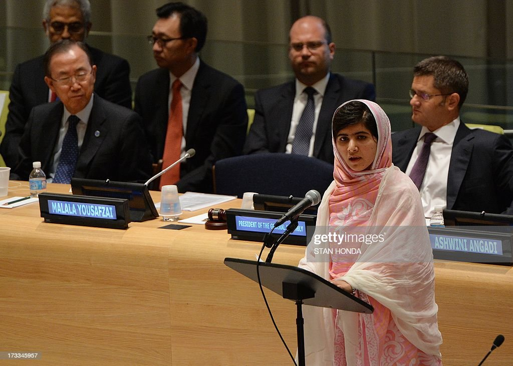 Pakistani student Malala Yousafzai speaks before the United Nations Youth Assembly July 12, 2013 at UN headquarters in New York as UN Secretary General Ban Ki-Moon (L) and Vuk Jeremic (R), President of the UN General Assembly listen. Yousafzai became a public figure when she was shot by the Taliban while travelling to school last year in Pakistan -- targeted because of her committed campaigning for the right of all girls to an education. The UN has declared July 12 'Malala Day', which is also Yousafzai's birthday, and will host the UN Youth Assembly. AFP PHOTO/Stan HONDA