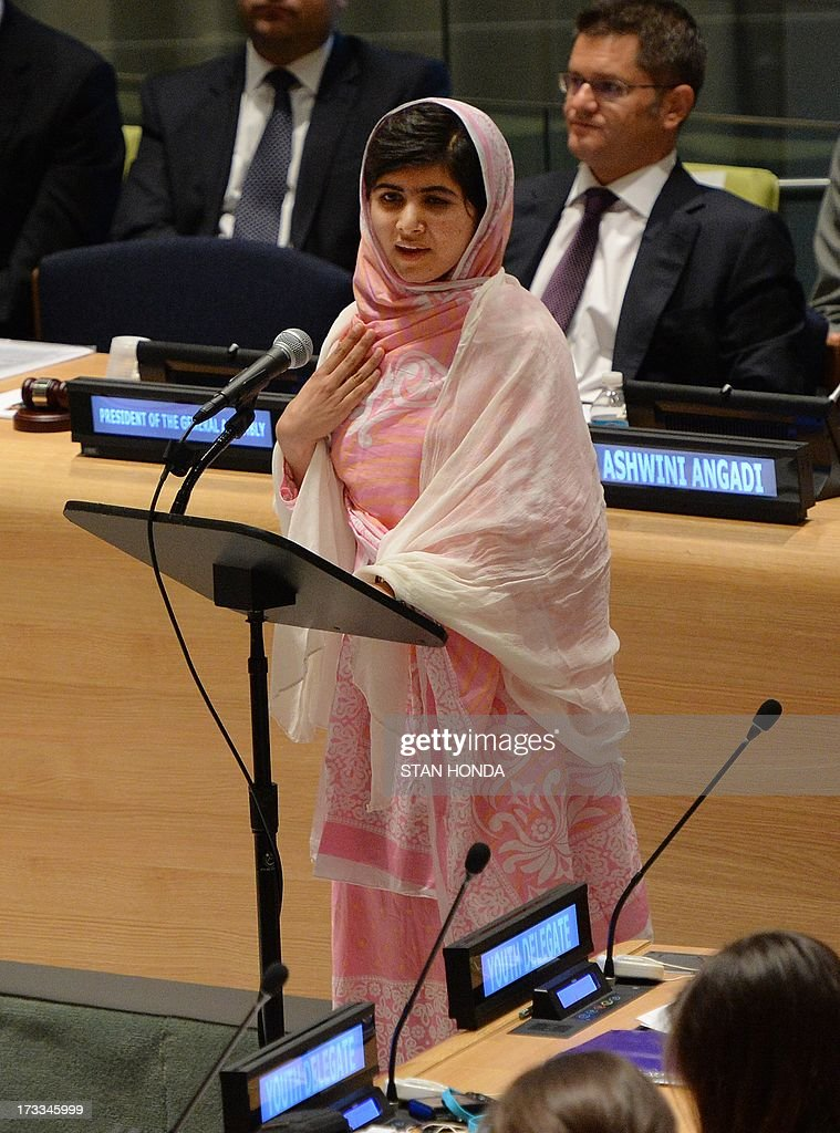 Pakistani student Malala Yousafzai speaks before the United Nations Youth Assembly July 12, 2013 at UN headquarters in New York as Vuk Jeremic (R), President of the UN General Assembly listens. Yousafzai became a public figure when she was shot by the Taliban while travelling to school last year in Pakistan -- targeted because of her committed campaigning for the right of all girls to an education. The UN has declared July 12 'Malala Day', which is also Yousafzai's birthday, and will host the UN Youth Assembly. AFP PHOTO/Stan HONDA