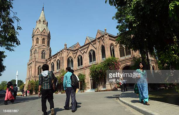 Pakistani students arrive at the government college university in Lahore on October 24 2012 AFP PHOTO / ARIF ALI