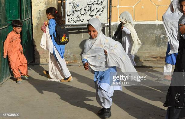 Pakistani students arrive at their school in the hometown of Nobel Peace Prize winner child education activist Malala Yousafzai in Mingora in...