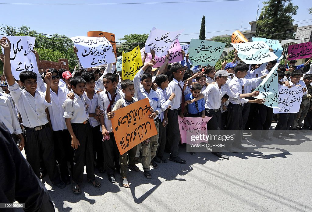Pakistani students carry placards as they march during a protest in Rawalpindi on May 21, 2010, against the published caricatures of Prophet Mohammed on Facebook. Thousands of Pakistanis were expected to take to the streets to vent growing anger against Facebook and the West over 'sacrilegious' caricatures of the Prophet Mohammed on the Internet. A Facebook user organised an 'Everyone Draw Mohammed Day' competition to promote 'freedom of expression', inspired by an American woman cartoonist, but sparked a major backlash in the conservative Muslim country of 170 million.