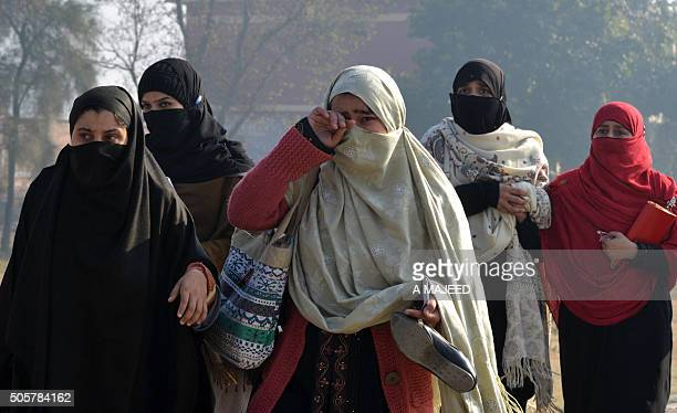 Pakistani students come out from the Bacha Khan university following an attack by militants in Charsadda about 50 kilometres from Peshawar on January...
