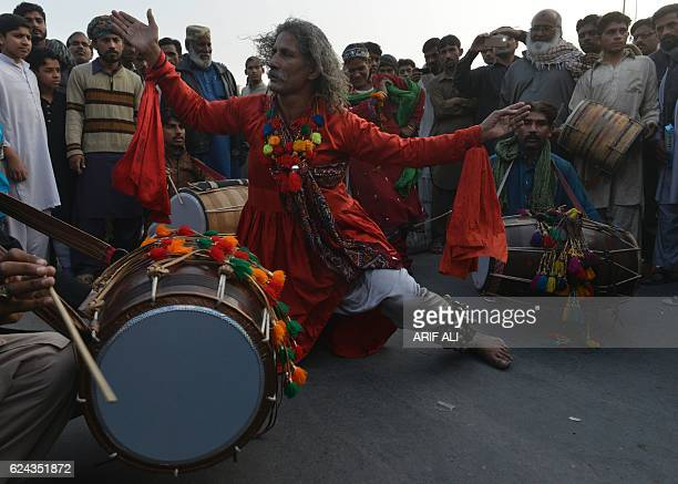 A Pakistani Sufi dances outside the Data Darbar complex which contains the shrine of Saint Syed Ali bin Osman AlHajvery popularly known as Data Ganj...