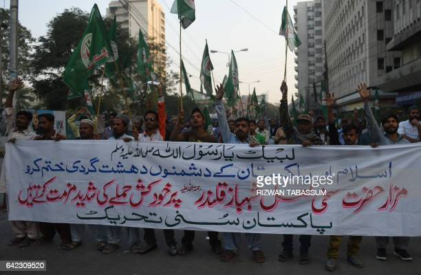 Pakistani Sunni Muslims shout slogans during a protest in Karachi on February 17 against a bomb attack on the shrine of 13th century Muslim Sufi...