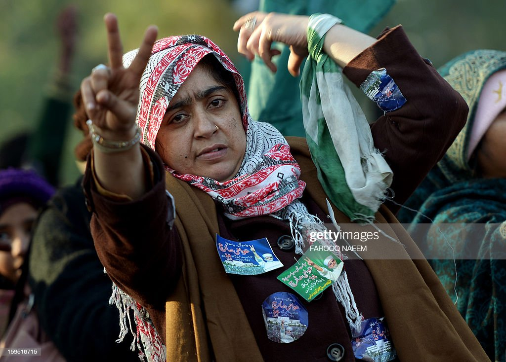 A Pakistani supporter of Canadian-Pakistani cleric Tahir-ul Qadri gestures during a protest march in Islamabad on January 15, 2013. Police fired tear gas on protesters in Islamabad as clashes erupted with followers of a cleric who led a march on the city demanding a peaceful 'revolution' and the dissolution of parliament. AFP PHOTO/ Farooq NAEEM