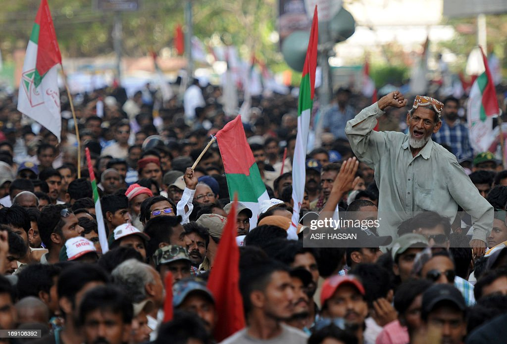 A Pakistani supporter of Muttahida Qaumi Movement (MQM) party, shouts slogans during a protest against Imran Khan, the head of Pakistan Tehreek-e-Insaf (PTI) party, in Karachi on May 20, 2013. Thousands of supporters of MQM, a powerful party in southern Pakistan, rallied to protest accusation by Imran Khan's party against MQM's party chief. The party of former Pakistani cricket hero Imran Khan secured victory in a repeat election held in one constituency of violence-plagued Karachi, election officials said Monday.