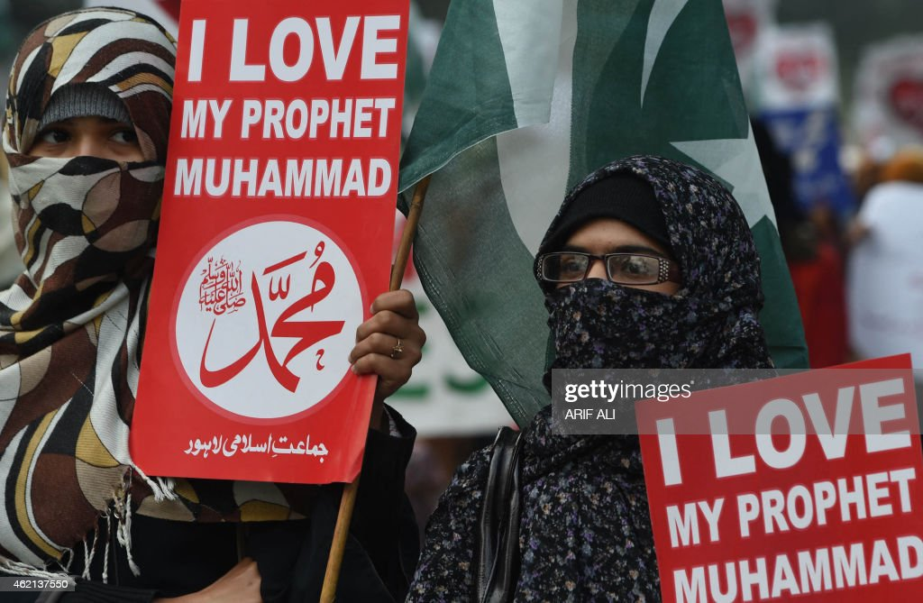 Pakistani supporter of political and Islamic party Jammat-e-Islami (JI) hold placards that read '<a gi-track='captionPersonalityLinkClicked' href=/galleries/search?phrase=Muhammad&family=editorial&specificpeople=3955327 ng-click='$event.stopPropagation()'>Muhammad</a>' as they gather during a protest against the printing of satirical sketches of the Prophet <a gi-track='captionPersonalityLinkClicked' href=/galleries/search?phrase=Muhammad&family=editorial&specificpeople=3955327 ng-click='$event.stopPropagation()'>Muhammad</a> by French magazine Charlie Hebdo in Lahore on January 25, 2015. Tens of thousands across Afghanistan, Pakistan and Muslim-majority Indian Kashmir took to the streets on January 23 for southern Asia's biggest protests yet against satirical magazine Charlie Hebdo's cartoon portrayal of the Prophet Mohammed. AFP PHOTO/ Arif ALI