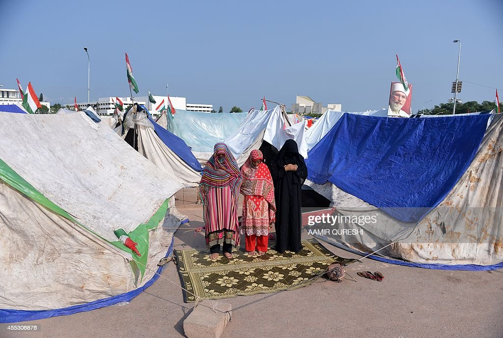 Pakistani supporters of Canadabased preacher TahirulQadri offer Friday prayers alongside their tent at an antigovernment protest site in front of...