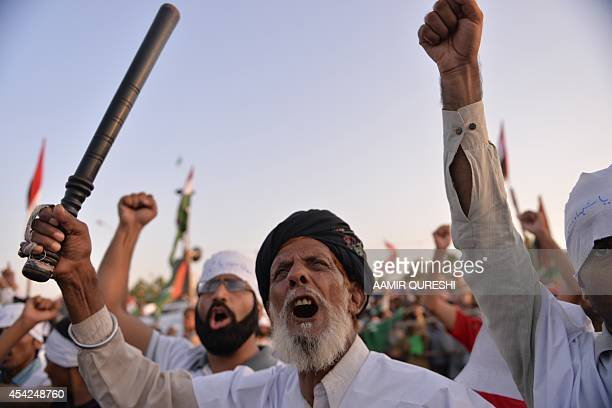 Pakistani supporters of Canadabased preacher TahirulQadri shout antigovernment slogans during a protest in front of the Parliament in Islamabad on...