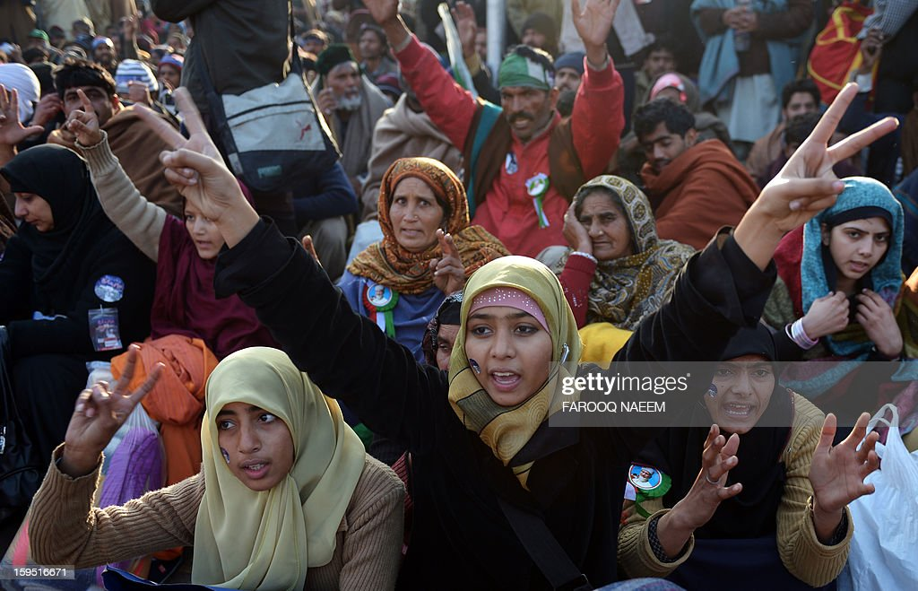 Pakistani supporters of Canadian-Pakistani cleric Tahir-ul Qadri chant slogans during a protest march in Islamabad on January 15, 2013. Police fired tear gas on protesters in Islamabad as clashes erupted with followers of a cleric who led a march on the city demanding a peaceful 'revolution' and the dissolution of parliament. AFP PHOTO/ Farooq NAEEM