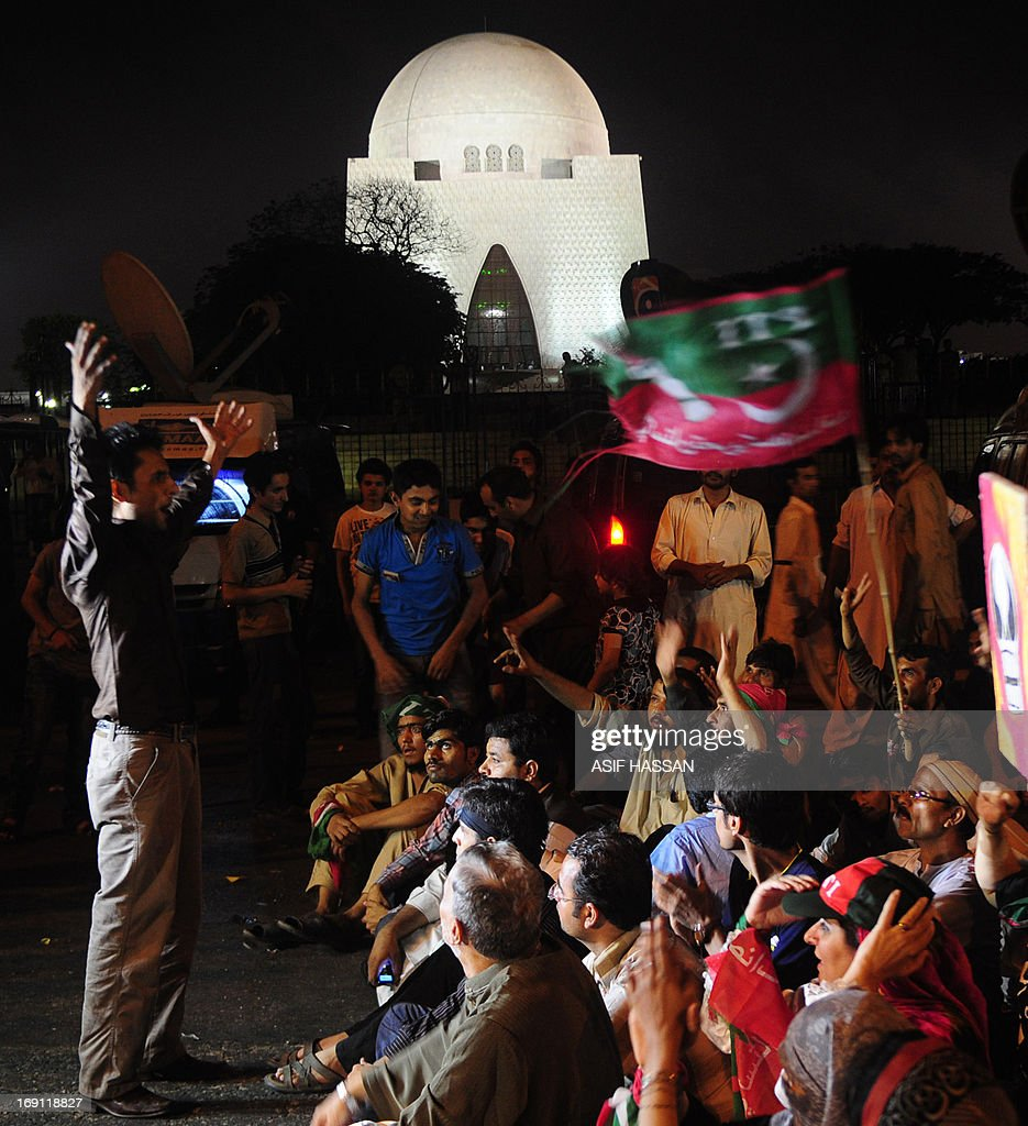 Pakistani supporters of Imran Khan, the head of Pakistan Tehreek-e-Insaf (PTI) party, take part in a protest against the killing of Sindh provincial party leader Zohra Hussain, in Karachi on May 20, 2013. The party of former Pakistani cricket hero Imran Khan secured victory in a repeat election held in one constituency of violence-plagued Karachi, election officials said Monday. Voting was held under tight security in 43 polling stations on May 19, a day after a senior official of Khan's Tehreek-e-Insaaf (PTI) party was shot dead outside her home in the city.