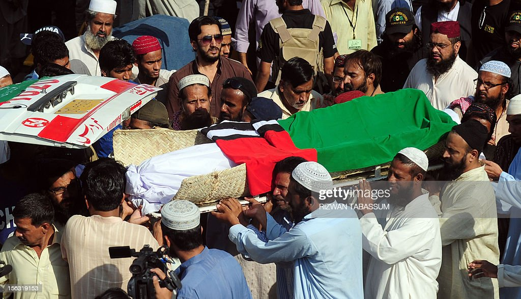 Pakistani supporters of Islamic party Ahl-i-Sunnat Wal Jamaat carry the coffin of an activist who was killed in a targeted killing in Karachi on November 13, 2012. Police in Karachi have arrested four suspected militants they said were planning a wave of sectarian attacks in the city, following a bloody three days in which around 40 people were killed. Pakistan's largest city is in the grip of political and sectarian violence between majority Sunni Muslims and minority Shiites, and the arrests come just days before the start of the holy month of Muharram. AFP PHOTO/Rizwan TABASSUM
