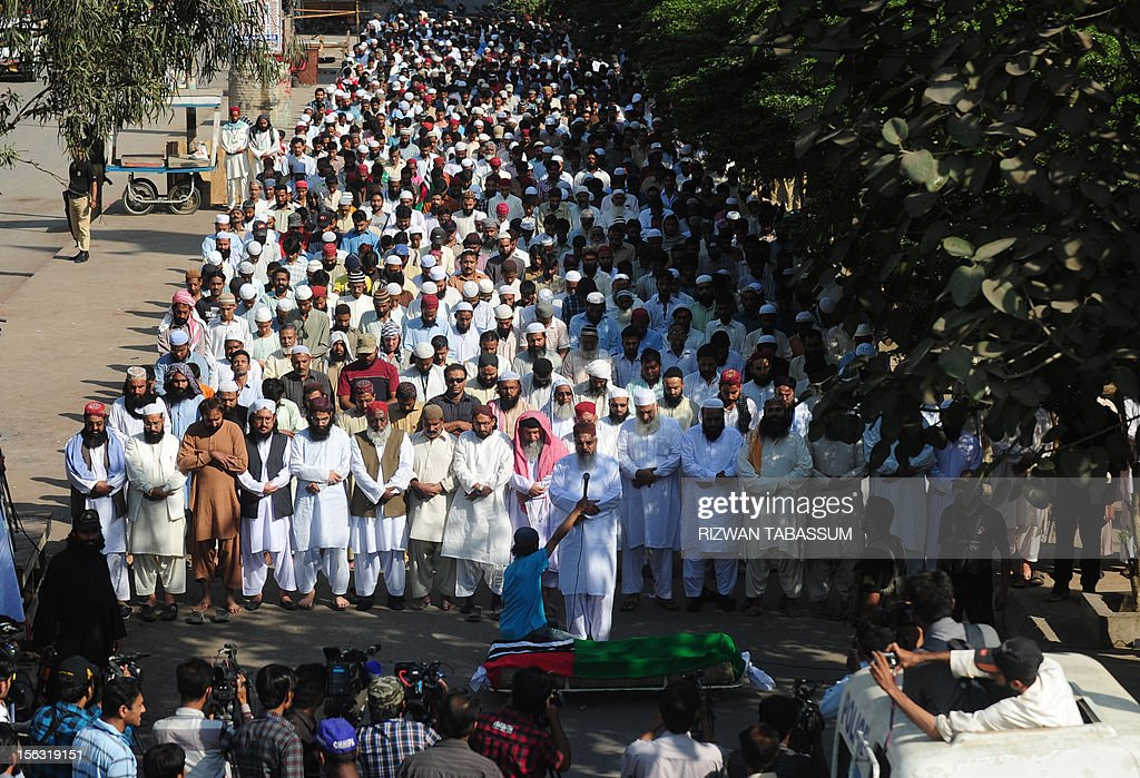 Pakistani supporters of Islamic party Ahl-i-Sunnat Wal Jamaat offer funeral prayers for an activist who was killed in a targeted killing in Karachi on November 13, 2012. Police in Karachi have arrested four suspected militants they said were planning a wave of sectarian attacks in the city, following a bloody three days in which around 40 people were killed. Pakistan's largest city is in the grip of political and sectarian violence between majority Sunni Muslims and minority Shiites, and the arrests come just days before the start of the holy month of Muharram. AFP PHOTO/Rizwan TABASSUM