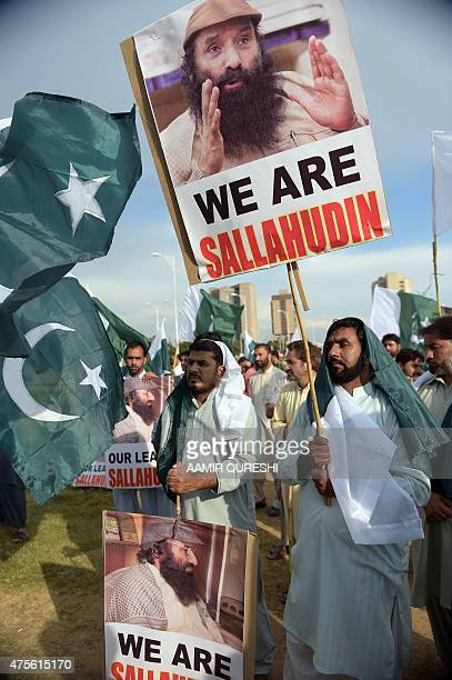 Pakistani supporters of political and Islamic party JammateIslami shout antiIndian slogans as they hold placards with images of Syed Salahuddin...