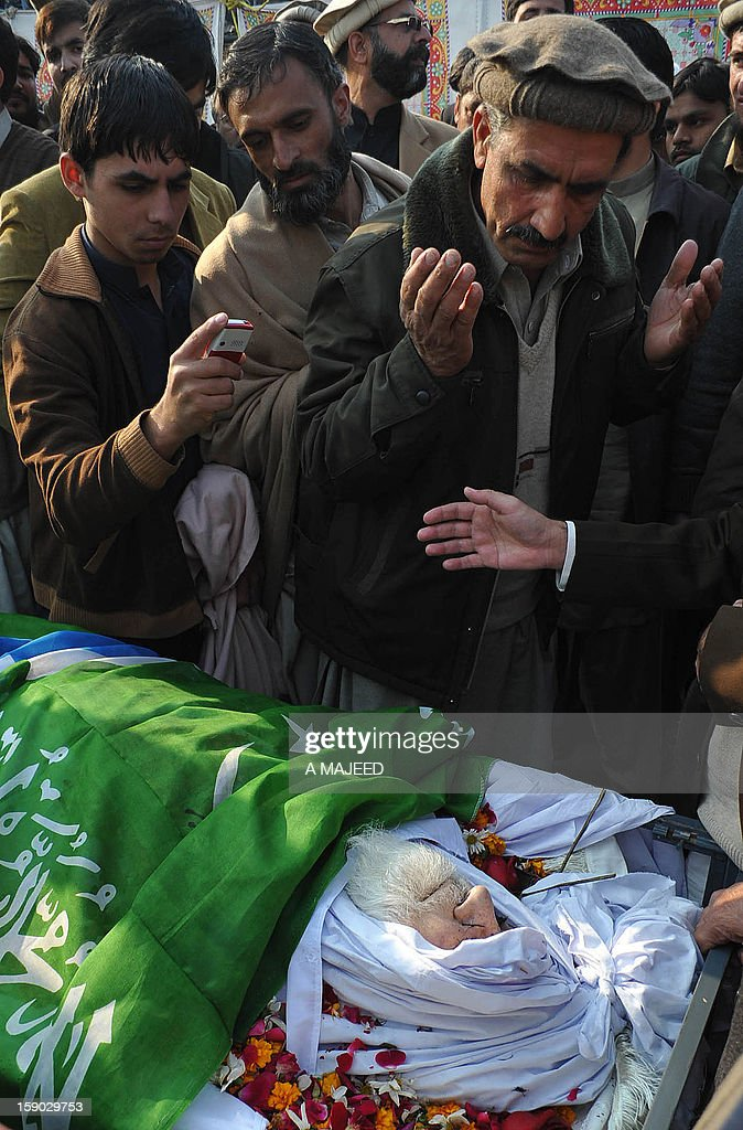 Pakistani supporters pray in front of the coffin of former Jamaat-i-Islami (JI) chief and politician Qazi Hussain Ahmed during a funeral ceremony in Peshawar on January 6, 2013. Ahmed (74), a prominent religious scholar remained a strong critic of counter-terrorism policy of the United States, and was widely known for his opposition of the United States participation in the war in neighboring Afghanistan.