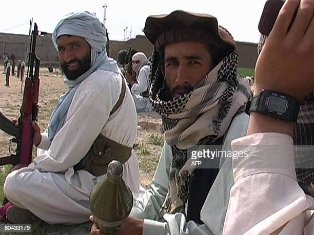 Pakistani Taliban militants gather during a public rally in Inayat Kili a small trading rural town some 10 kms north of Khar the main town of Bajaur...