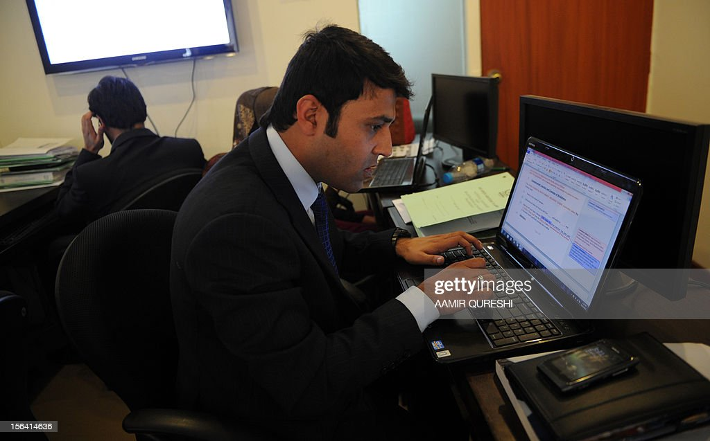 Pakistani tax official works on his laptop at a tax office in Islamabad on November 14, 2012. Pakistan is banking on a new amnesty to bring millions of tax evaders into the revenue net but analysts warn the scheme is a charter for cheats that will encourage money laundering and could 'destroy the tax system'. The chairman of the Federal Board of Revenues (FBR) Ali Arsahd Hakeem told AFP that the country's main revenue collection authority, is hoping to lure up to three million non-payers with a special offer, though he conceded it was a 'gigantic task'. Total tax revenue amounted to a paltry 9.6 percent of GDP in 2010-11, among the lowest in the world. AFP PHOTO/Aamir QURESHI