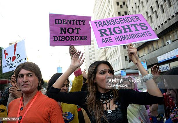 Pakistani transgenders carry placards as they rally to mark World Aids Day in Karachi on November 30 2013 World AIDS Day is celebrated on December 1...