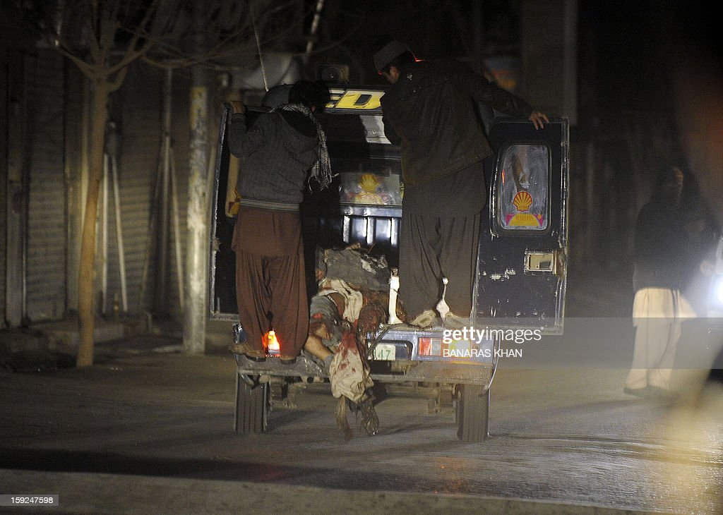 Pakistani transport the dead bodies of blast victims after a bomb attack in Quetta on January 10, 2013. At least 10 people were killed as two successive bombs exploded outside a snooker club in the southwestern city of Quetta late, hours after a separate blast left 11 dead, police said. AFP PHOTO / BANARAS KHAN