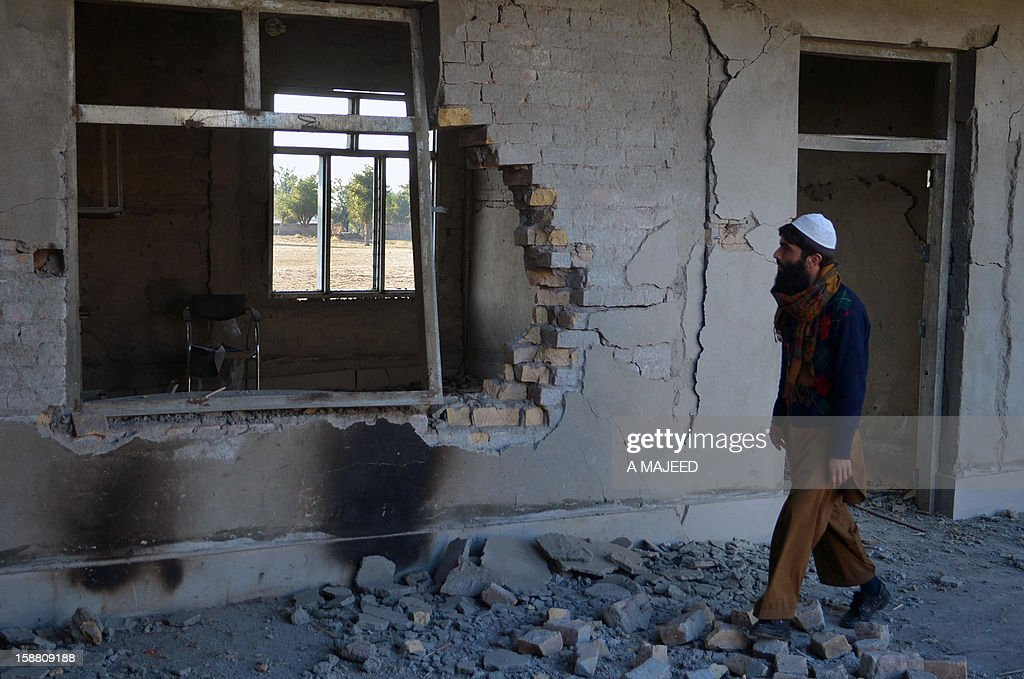 A Pakistani tribesman looks a damage building of a paramilitary camp in Darra Adam Khel on December 30, 2012, which was attacked by Taliban militants. Taliban militants have shot dead 21 Pakistani soldiers who they had kidnapped in raids on two camps outside Peshawar in the troubled northwest of the country, officials said.
