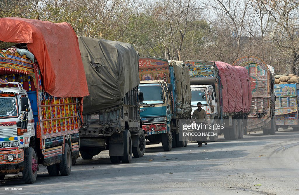 A Pakistani truck driver walks past vehicles parked on a highway in protest of the February 16 Quetta bombing against Shiite Muslims, in Islamabad on February 19, 2013. Pakistani forces on Tuesday killed four men and arrested seven others accused of killing Shiite Muslims, including an alleged mastermind of a bomb attack that killed 89 people, officials said. AFP PHOTO/Farooq NAEEM