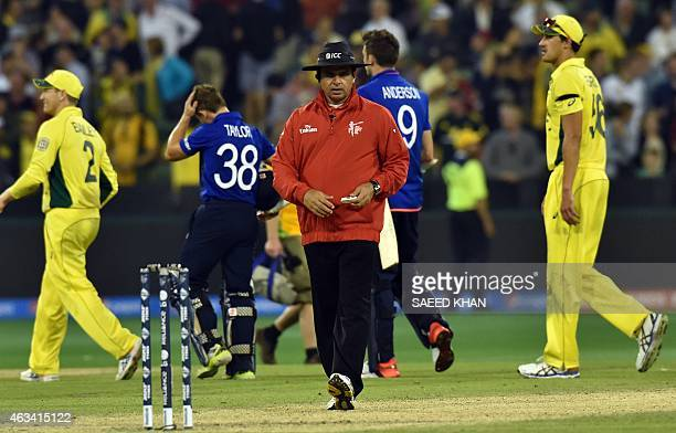 Pakistani umpire Aleem Dar approaches to the stumps after the Pool A 2015 Cricket World Cup match between Australia and England at the Melbourne...