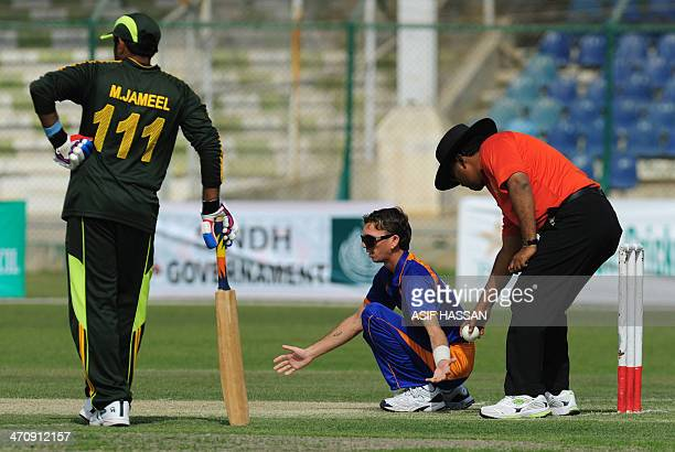 Pakistani umpire Muhammad Daud guides blind Indian cricketer Kitan as he bowls during a oneday match between India and Pakistan's blind cricket teams...