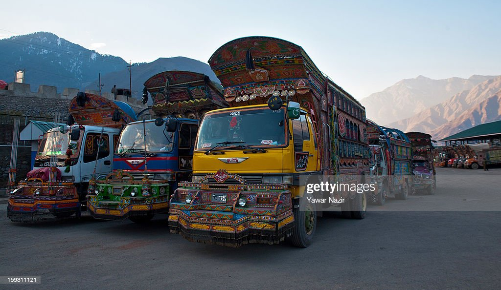Pakistani vehicles unload their goods at the trade facilitation centre in the border area near Uri on January 11, 2013 in Salamabad, 120 km (75 miles) northwest of Srinagar, the summer capital of Indian Administered Kashshmir, India. People living in the mountainous region along the Line of Control (LOC), a military line that divides Indian-administered Kashmir from the Pakistan-administered Kashmir have continually been at risk due to hostility between the armies of the two rival nations, but trade has been carried out smoothly across the Line of Control in North Kashmir. Two Indian and two Pakistani soldiers have been killed in the last week near the Line of Control dividing Kashmir, with both countries blaming each other for the escalating tension.